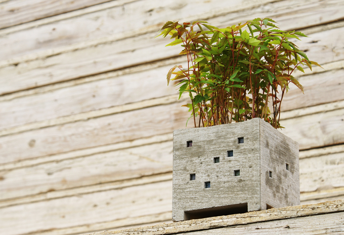 Miniature building shaped flower pots by Pull + Push